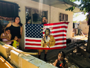 A family responds to the car protest in Albuquerque. Liberation photo.